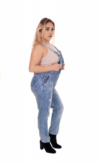 Lovely blond woman standing in profile in working jeans