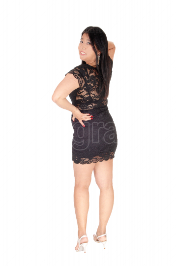 Lovely Chinese woman standing from the back in black dress