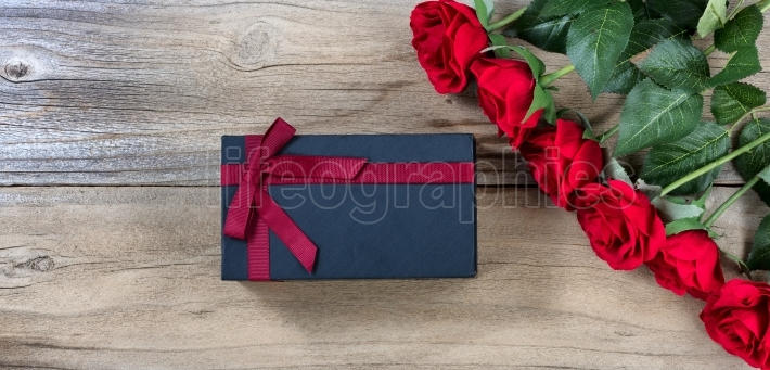 Lovely holiday gifts on weathered wooden background