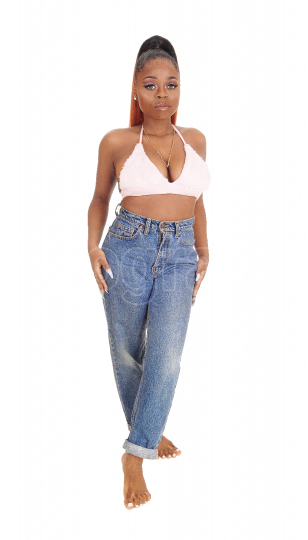 Lovely young African woman in jeans and bra
