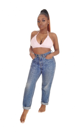 Lovely young African woman in jeans and pink bra