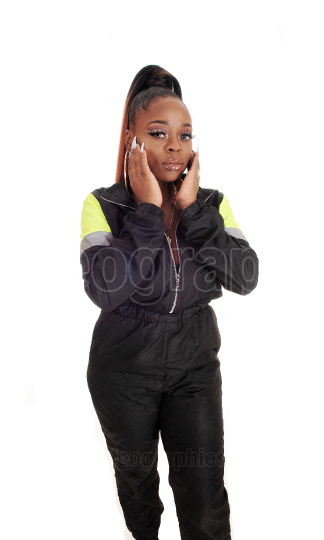 Lovely young African woman standing in a tracksuit