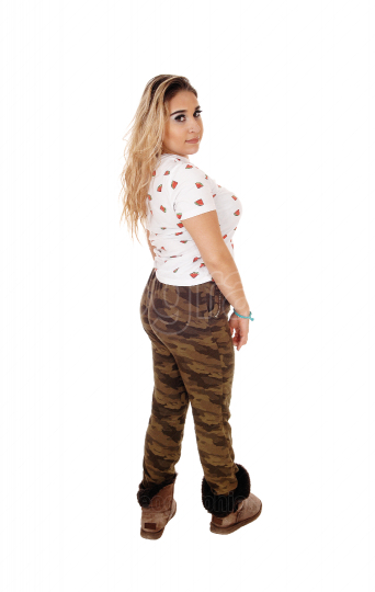 Lovely young woman in camouflage pants