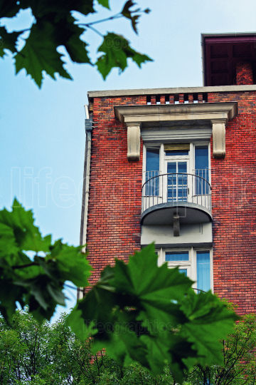 Low angle view of a balcony on a red brick building