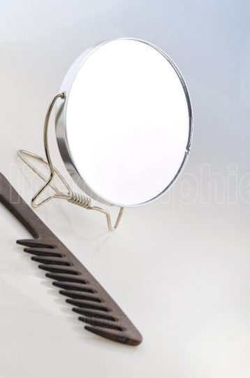 Makeup mirror with hair brush