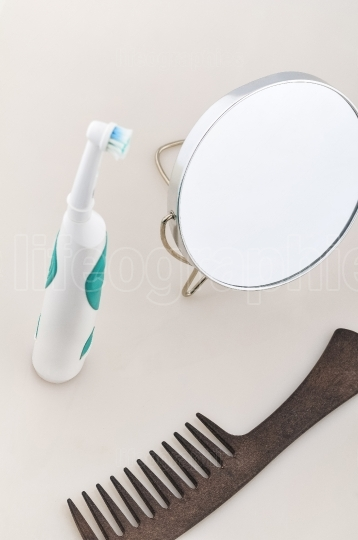 Makeup mirror with hair brush and toothbrush