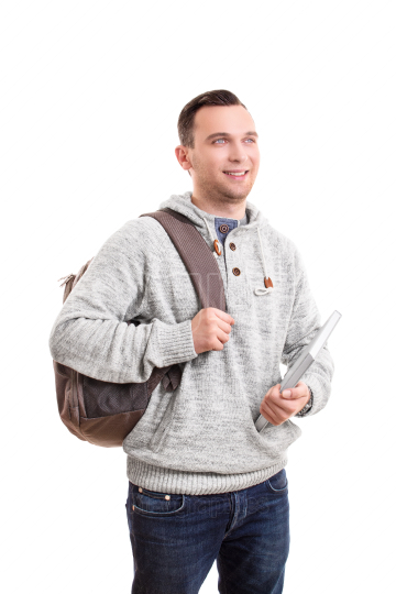 Male student with a backpack holding a notebook
