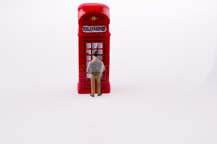 man and telephone booth