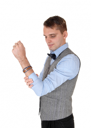 Man checking his insured arm for the pain