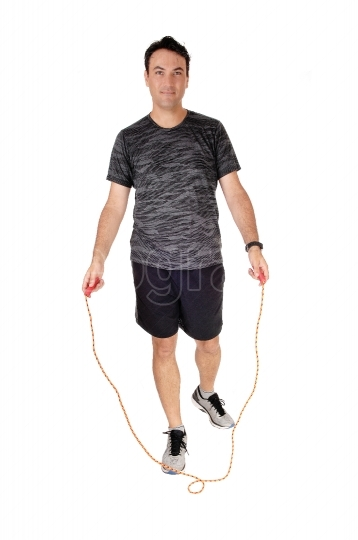 Man exercising in the studio with his rope