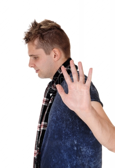 Man holding a hand up saying no