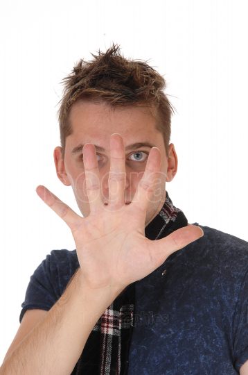 Man holding his hand up looking trough his fingers