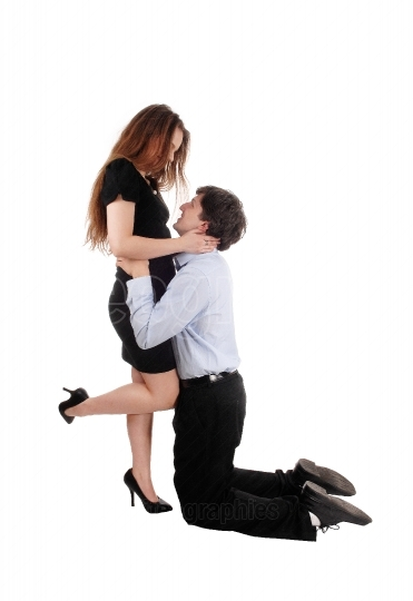 Man kneeling in front of his girlfriend