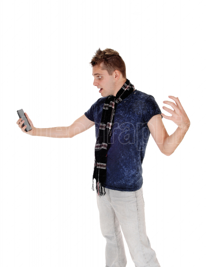 Man looking stunning at his cell phone wondering