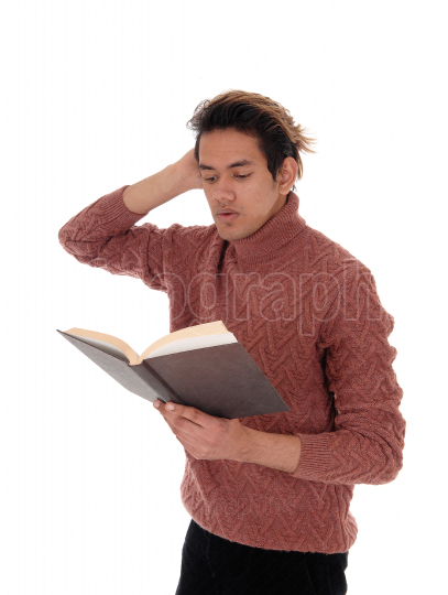 Man standing and reading in his book, looks surprised