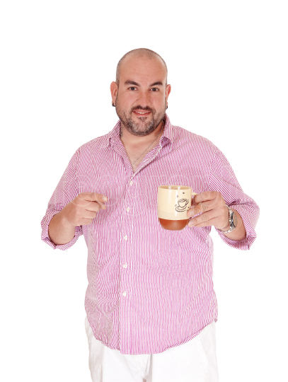 Man standing with a cup of coffee