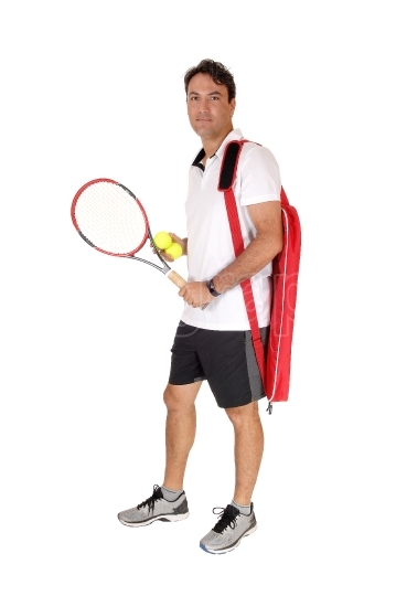 Man standing with his tennis tools, smiling