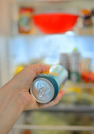Man taking beer from fridge