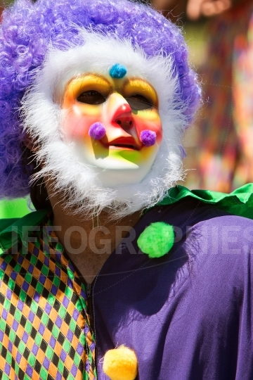 Man Wearing Colorful Clown Costume And Mask Celebrates Caribbean