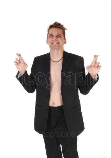 Man with out shirt and jacket standing with fingers crossed