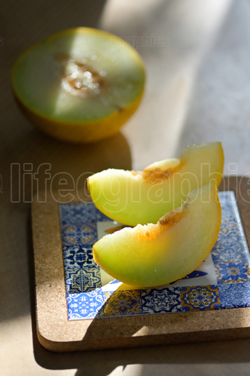 Melon with slices on a table