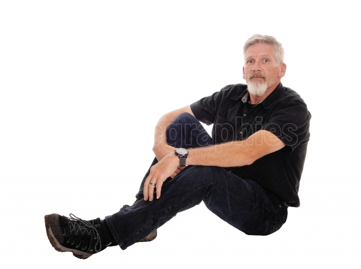 Middle age man sitting on floor
