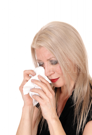 Middle age woman crying with her tissue in her hand