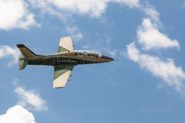 Military fighter airplane in the blue sky