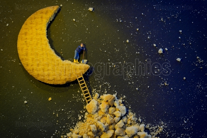 Miniature worker repairing the half moon