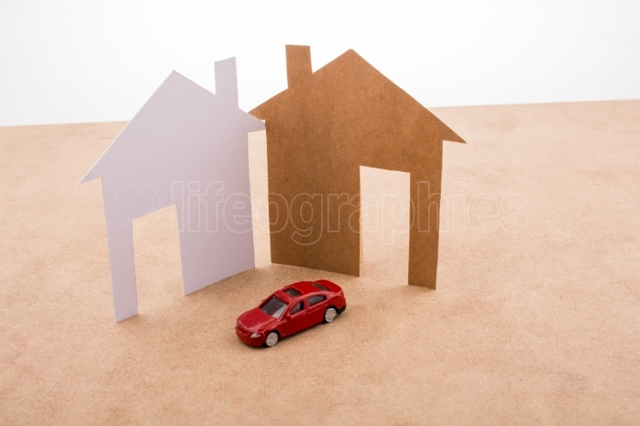 Model car and house shape cut out of paper