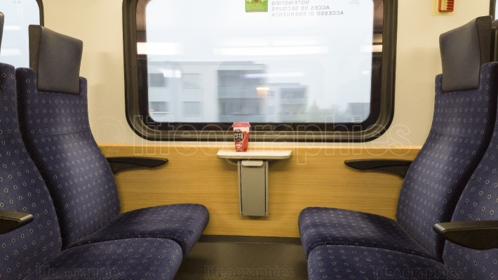 Modern train seats and window with a coffee on the table