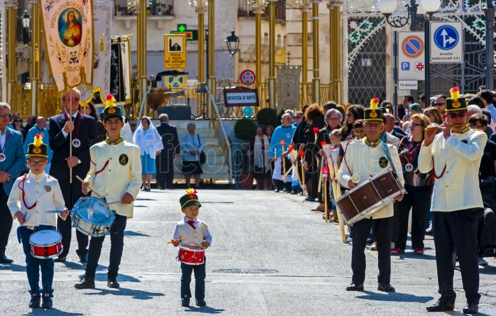 MODUGNO, ITALY   September 27, 2015  Group of musicians with drums of various sizes during a religious procession  There are several generations of the same family