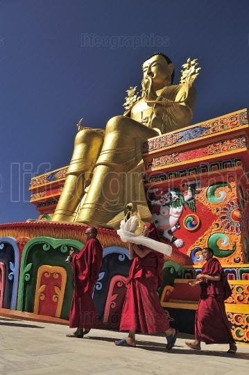Monks ready for daily puja near golden buddha from likir monastery