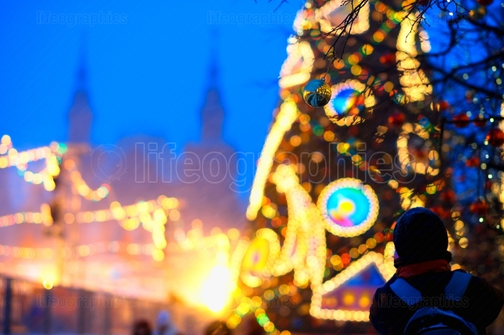 Moscow Christmas tree decoration with tourist bokeh