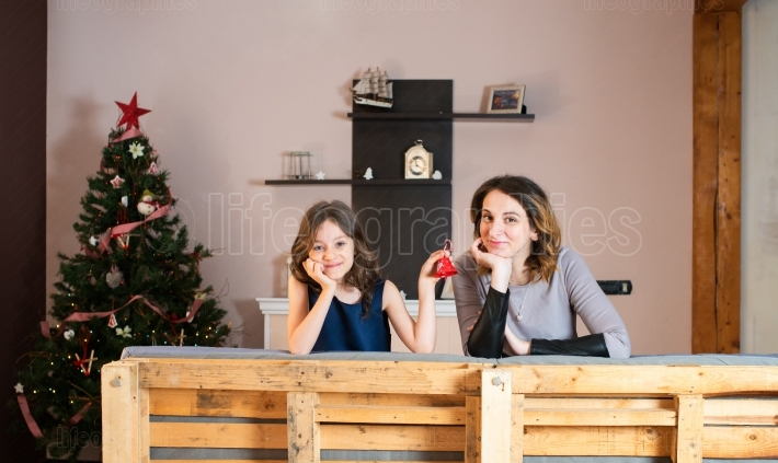 Mother and her daughter announcing christmas