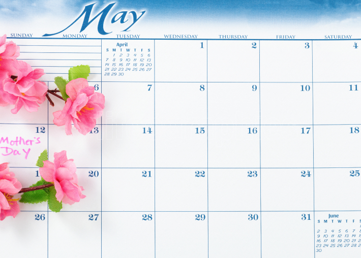 Mothers Day holiday date marked on calendar with cherry blossoms
