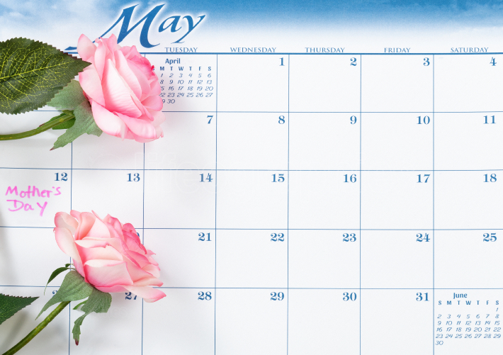 Mothers Day holiday date marked on calendar with pink roses