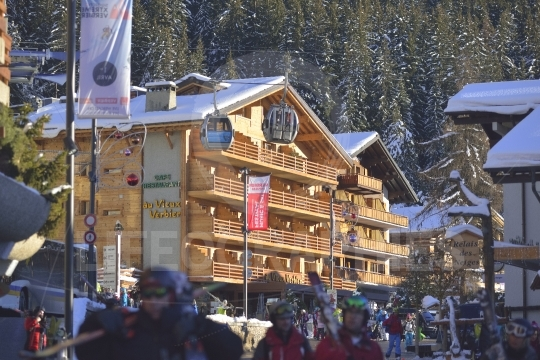 Mountain village with with skiers