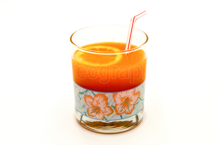 Multifruit juice in a glass with a straw