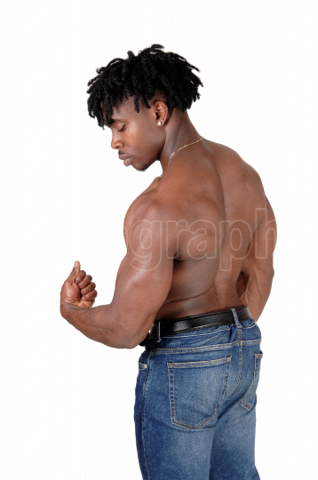 Muscular black man standing shirtless from the back