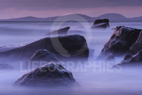Mysterious sunset among the rocks