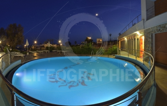 Night view of a swimming pool from a caravan camping site. Varazze, Italy