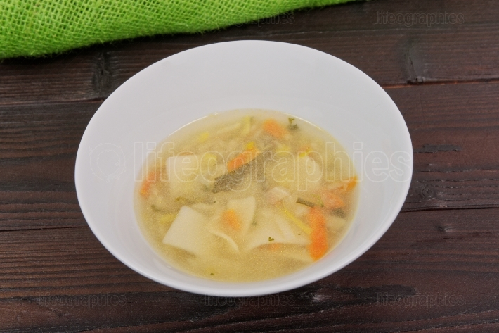 Noodle soup with vegetables on a table