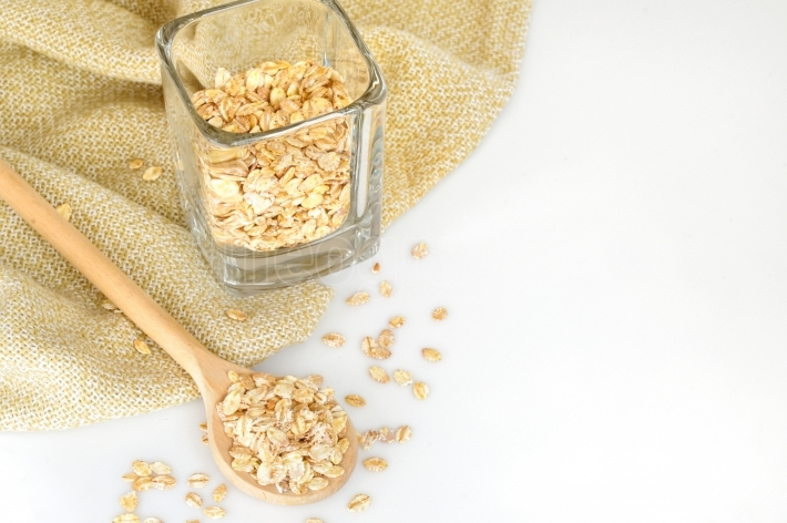 Oat-flakes with a wooden spoon