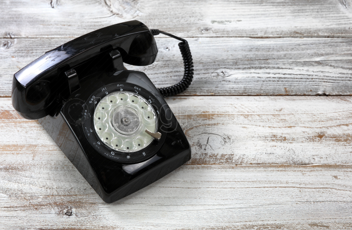 Old fashion rotary dial phone for antique technology concept in