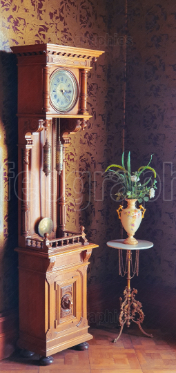 Old fashioned grandfather clock and antique vase
