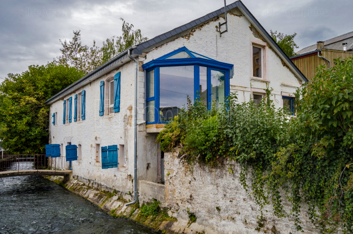 Old house along the river of tone with blue shutters