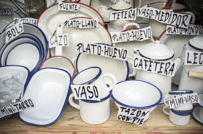 Old spanish shop offering enamel ware  Vintage white ware made f