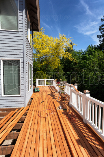 Outdoor wooden deck being completely remodeled during springtime