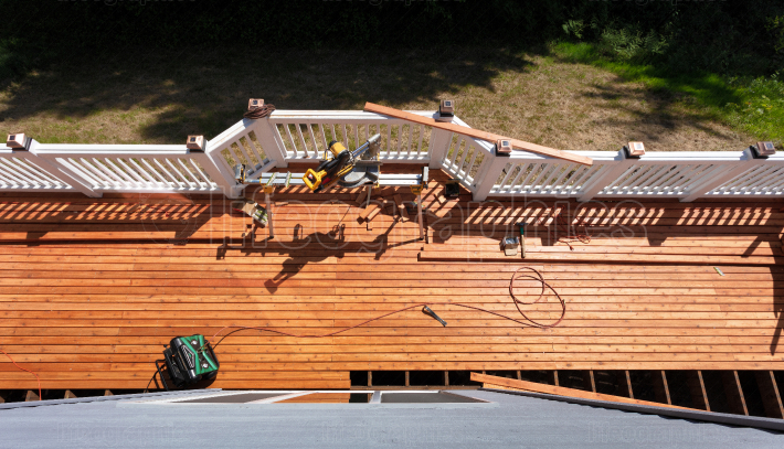 Overhead view of outdoor cedar wooden deck being remodeled with